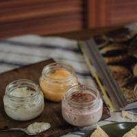 A PARTY OF BOTTLED DIPS SERVED WITH FLATBREADS AND BREADSTICKS
